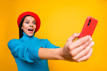 Close-up portrait of nice attractive lovely cheerful cheery girl taking making selfie having fun time holiday fooling isolated over bright vivid shine vibrant yellow color background Banco de Imagens - 138272286