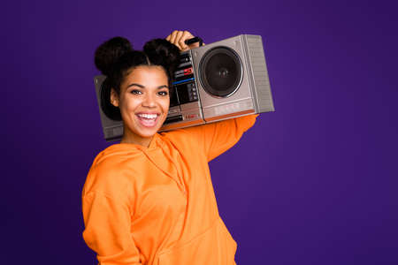 Close-up portrait of her she nice attractive funky cool cheerful cheery brunette girl in hoody carrying boom box isolated over bright vivid shine vibrant lilac violet purple color background