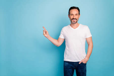 Portrait of his he nice attractive cheerful cheery guy showing copy empty blank space good news isolated on bright vivid shine vibrant teal green blue turquoise color background