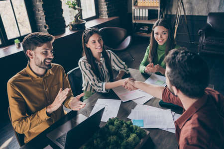 Congratulations you get job. Positive three people hire new experience practice student win contract hand shake enjoy start-up partnership deal victory workshop sit table workplace