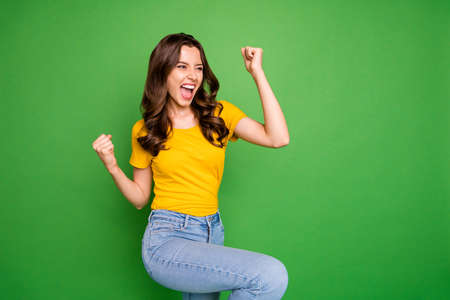 Portrait of her she nice attractive lovely pretty cute successful cheerful cheery, wavy-haired girl dancing celebrating isolated on bright vivid shine vibrant green color background Фото со стока