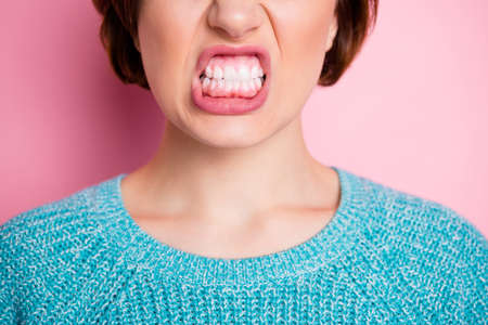 Cropped close-up view portrait of her she nice attractive fury evil cruel woman grinning teeth healthy gums anti caries isolated over pink pastel color background