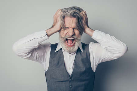 Thats enough. Close up photo of frustrated old businessman company owner suffer crisis touch hair shout wear white shirt isolated over grey color background