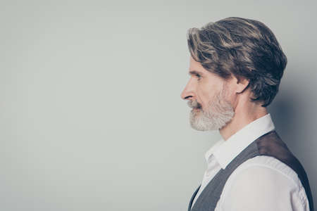 Closeup profile photo of aged handsome business man looking empty space seriously not smiling wear white shirt waistcoat isolated grey color background Banco de Imagens