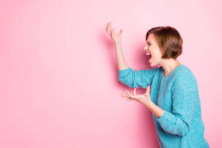 Side profile photo portrait of angry aggressive girl gesturing hands screaming acting isolated pink copyspace background Stock Photo