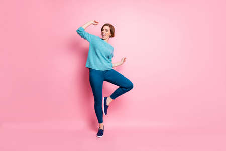 Full length body size view of her she nice attractive lovely funky cheerful cheery brown-haired woman having fun dancing carefree lifestyle isolated over pink pastel color background Stock fotó