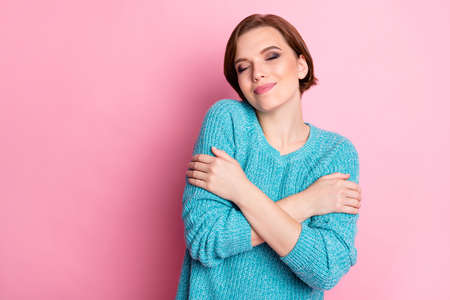 Close-up portrait of her she nice-looking attractive lovable sweet lovely cheerful cheery gentle brown-haired woman hugging herself isolated over pink pastel color background