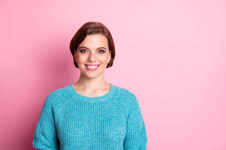 Close-up portrait of her she nice-looking attractive lovely cheerful cheery kind content brown-haired girl wearing blue jumper isolated over pink pastel color background Stock fotó