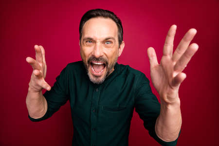 Close-up portrait of his he nice attractive annoyed irritated crazy bearded brown-haired man yelling pretense isolated on bright vivid shine vibrant maroon burgundy marsala red color background