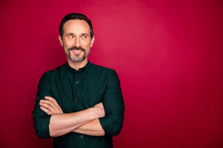 Close-up portrait of his he nice attractive cheerful cheery bearded smart clever successful man manager folded arms isolated on bright vivid shine vibrant maroon burgundy marsala red color background