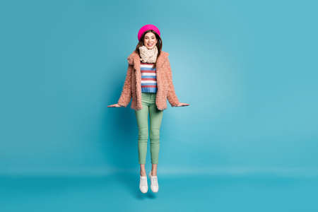 Full length body size view of her she nice-looking fashionable attractive dreamy cheerful cheery girl jumping having fun isolated on bright vivid shine vibrant green blue turquoise color background