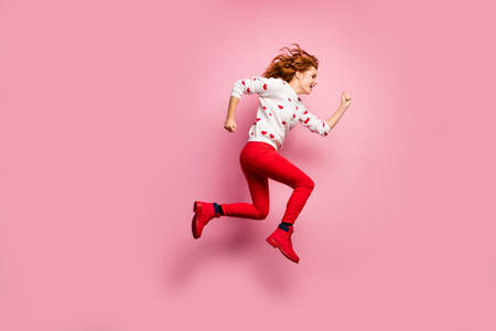 Full length body size view of nice attractive cheerful cheery foxy ginger wavy-haired girl running fast active lifestyle sporty regime gift delivery isolated on pink pastel color background Banco de Imagens