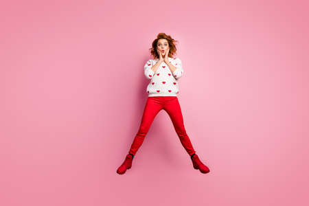 Full length body size view of her she nice attractive lovely lucky cheerful cheery foxy ginger wavy-haired girl jumping having fun cool great news success isolated on pink pastel color background
