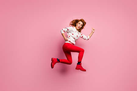 Full length body size view of nice attractive girlish cheerful cheery foxy ginger wavy-haired girl running fast active energetic lifestyle grimacing pout lips isolated on pink pastel color background