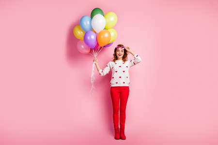 Full length body size view of her she nice attractive pretty glad ecstatic cheerful cheery dreamy wavy-haired girl holding in hand bunch balls birthday fest isolated on pink pastel color background Banco de Imagens