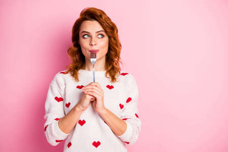 Close-up portrait of her she nice attractive pretty dreamy cheerful wavy-haired girl licking fork want wish desire tasty yummy meal temptation seduction isolated on pink pastel color background