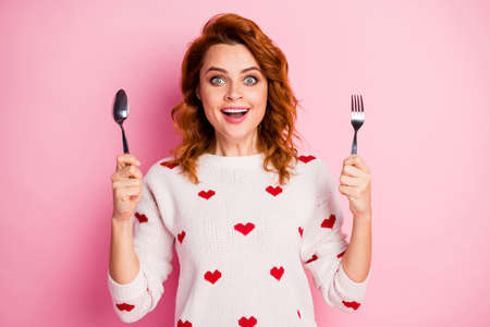 Close-up portrait of her she nice attractive lovely pretty glad cheerful cheery wavy-haired girl holding in hands crockery expecting tasty yummy festal meal isolated on pink pastel color background
