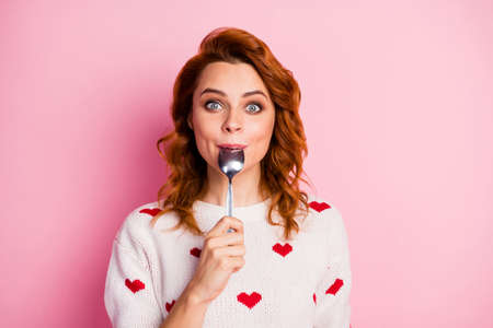 Close-up portrait of her she nice attractive pretty cute glad cheerful cheery wavy-haired girl licking spoon celebratory festal lunch homemade breakfast isolated on pink pastel color background