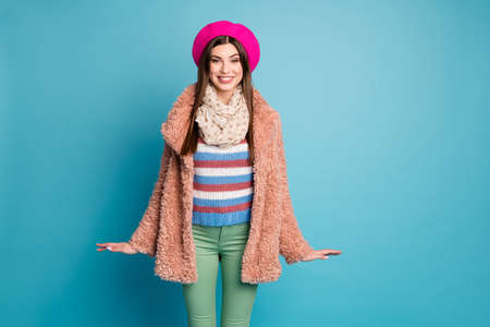 Portrait of lovely charming girl enjoy fun autumn walk wear fur pastel overcoat jumper outfit dotted shawl isolated over blue color background