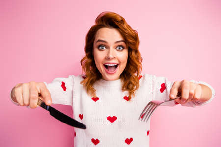 Close-up portrait of nice attractive addicted cheerful cheery foxy ginger wavy-haired girl holding in hands crockery tasty yummy meal fast delivery overeat isolated on pink pastel color background