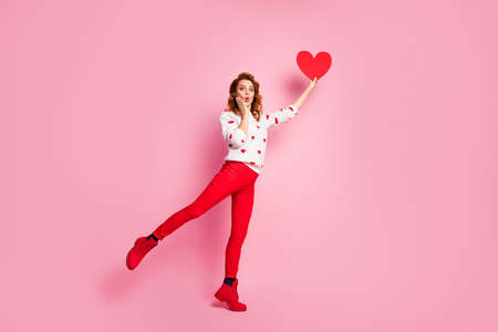 Full length body size view of her she nice attractive lovely fashionable amazed cheerful cheery wavy-haired girl holding in hand rising heart dream first date isolated on pink pastel color background