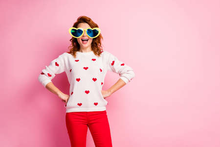 Portrait of her she nice attractive lovely pretty glad excited funny cheerful cheery wavy-haired girl wearing theme party festal look trendy apparel isolated on pink pastel color background