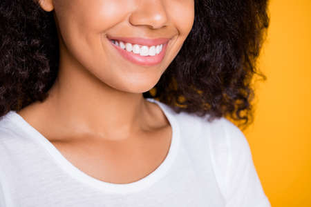Cropped close-up profile side view portrait of her she nice attractive, lovely cheerful cheey wavy-haired girl teeth treatment isolated over bright vivid shine vibrant yellow color background