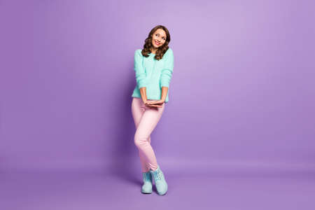 Full body photo of beautiful lady flirty good mood look up empty space dreamer coquette wear pastel fluffy pullover pink pants boots isolated purple color background