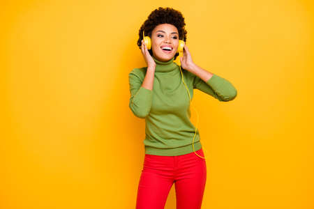 Portrait of her she nice attractive lovely charming cute positive cheerful cheery brown wavy-haired girl listening music soul funk isolated over bright vivid shine vibrant yellow color background
