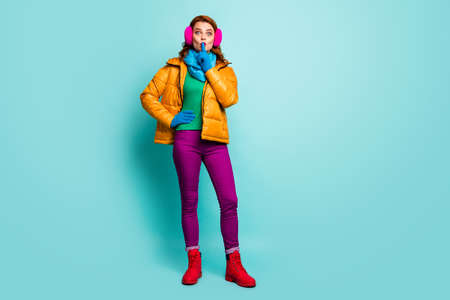 Hush secret. Full length photo amazed woman dont share private information put index finger mouth wear yellow boots purple pants trousers green jumper isolated teal color background