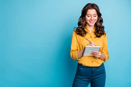 Portrait of her she nice attractive lovely pretty focused cheerful cheery wavy-haired girl writing love story isolated on bight vivid shine vibrant green blue turquoise color background