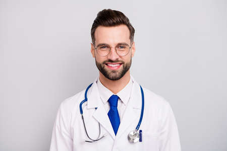 Close-up portrait of his he nice attractive smart clever cheerful cheery doc professor emergency center owner director ceo boss chief isolated on light white gray pastel color background Banco de Imagens