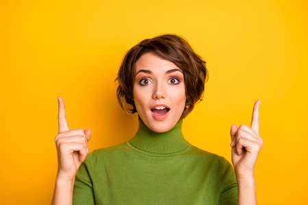 Close up photo of crazy astonished girl promoter point index finger up copyspace present incredible ads promo impressed scream wow omg wear good look jumper isolated bright color background Stock Photo