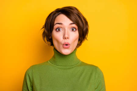 Closeup photo of short hairstyle pretty lady eyes full of fear frightened open mouth listen awful unexpected news wear casual green warm turtleneck isolated yellow color background
