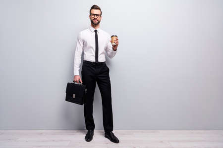 Full size photo positive cool smart freelancer promoter man hold cafeine beverage mug hold modern handbag ready partnership appointment wear good look white isolated grey color background