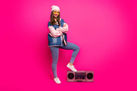 Full length body size view of her she nice attractive winsome cool cheerful cheery girl putting leg on boom-box having fun holiday isolated on bright vivid shine vibrant pink fuchsia color background 免版税图像