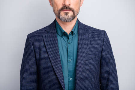 Cropped photo of attractive business mature man hiding facial expression no smile showing, perfect neat bristle formalwear shirt blazer blue suit isolated grey color background