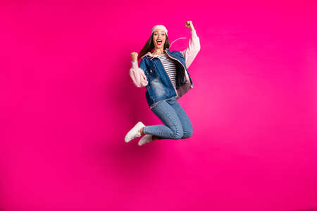 Full length body size view of her she nice attractive cool cheerful cheery girl jumping celebrating having fun time accomplishment isolated on bright vivid shine vibrant pink fuchsia color background