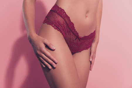 Cropped close-up view of nice adorable attractive thin fit babe lady girlfriend posing touching caressing perfect flawless sportive line figure erotica soft silky isolated over pink pastel background