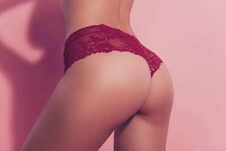 Cropped close-up profile side view of nice sportive adorable gorgeous thin fit babe lady girlfriend wife chic chick posing perfect curvy line figure tease isolated over pink pastel background Stockfoto
