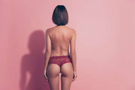 Rear back behind view of her she attractive graceful alluring brunette lady standing straight snap shot trend trendy isolated over pink pastel background Standard-Bild - 139981142