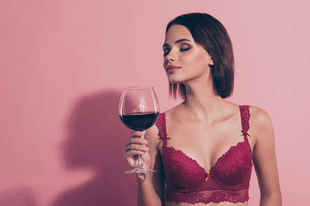 Portrait of her she nice sweet lovely attractive gorgeous glamorous winsome charming lady girlfriend wife holding red wine 8 march congrats aroma isolated over pink pastel background Standard-Bild - 139981146