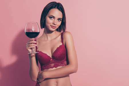Portrait of her she nice cute sweet lovely winsome attractive charming lady girlfriend wife holding red wine 8 march congrats isolated over pink pastel background Standard-Bild - 139981148