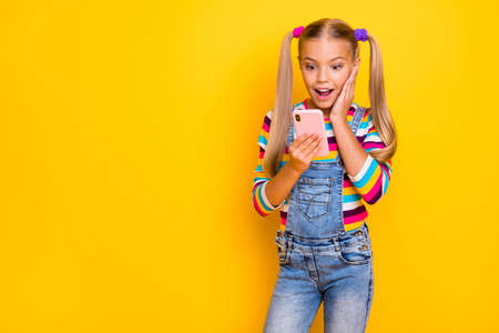 Omg new followers. Crazy energetic kid addicted blogger use smartphone read social media news impressed scream wear striped sweater jumper denim jeans isolated bright shine color background