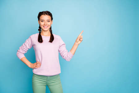 Portrait of her she nice attractive lovely cheerful cheery girl showing copy empty blank space place isolated bright vivid shine vibrant blue green teal turquoise color background Stock Photo