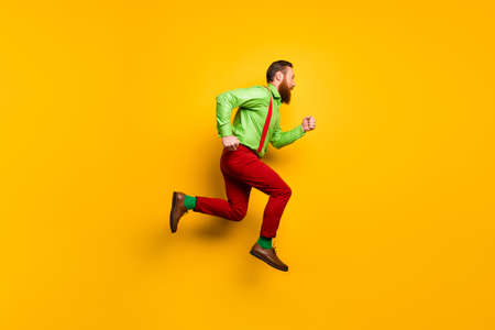 I need run faster. Full length profile side photo of focused irish gentleman jump hurry want buy shopping center discount wear good look outfit isolated over yellow color background