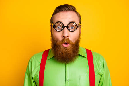 Close up photo of astonished bearded man with funky spectacles look wonder cant believe novelty wear stylish clothes isolated over vibrant color background Stock fotó