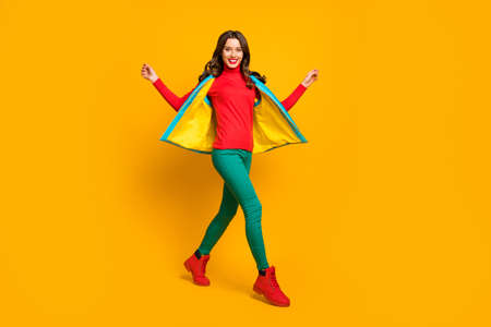 Full body photo of content cute sweet woman enjoy spring weekend go walk wear good look sweater shoes isolated over shine color background