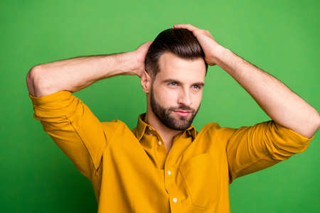 Close-up portrait of his he nice attractive well-groomed bearded guy touching hair modern coiffure haircut isolated over bright vivid shine vibrant green color background
