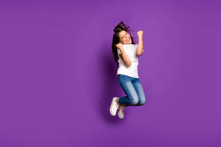 Full length body size view of her she nice triumphing cheerful wavy-haired girl jumping having fun isolated on bright vivid shine vibrant purple violet lilac color background